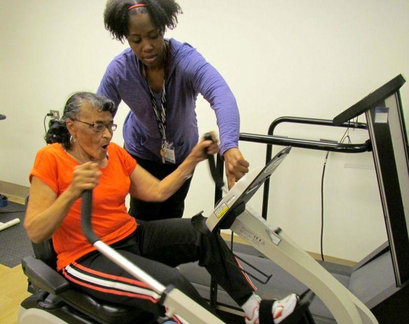 Mary exercising on an adaptive machine