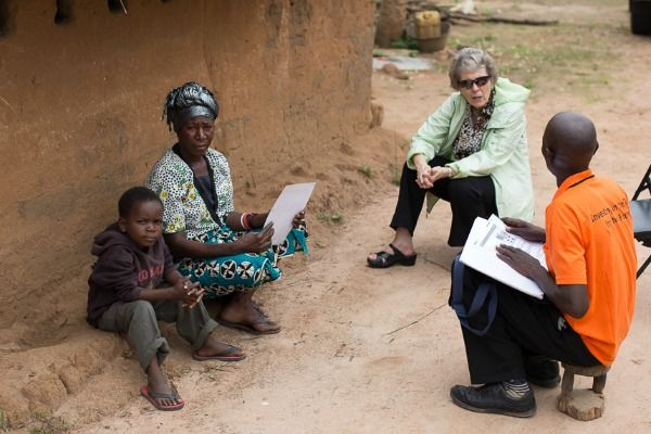Visit with a family and a volunteer engaged in the Zambia Anglican Council's ECD Program.