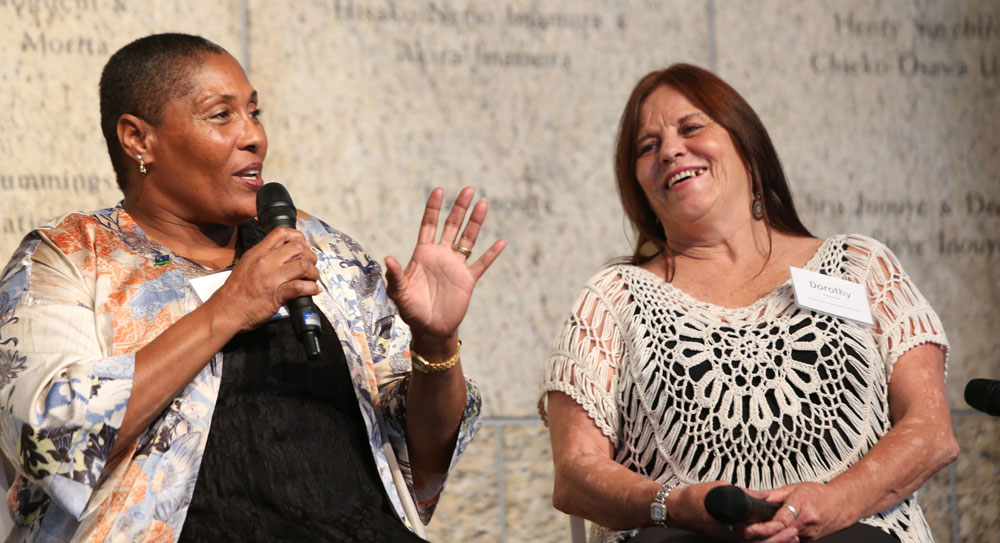 Photo of two women speaking at an event